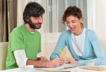 Smiling Couple Making Plans Studying