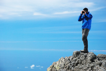 Photographer on top of the mountain