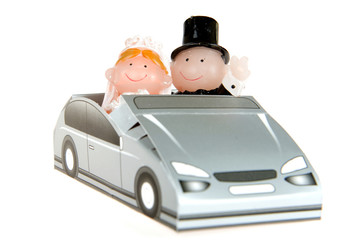 a bride and groom in a car