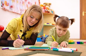 Teacher with child in preschool