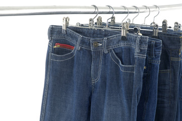 jeans on a hanger, isolated on white.
