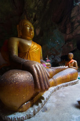 image of Buddha in the cave,Phetchburi Thailand