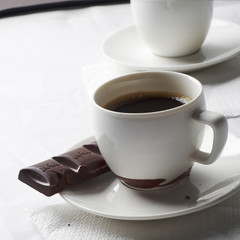 Cup of coffee with black chocolate