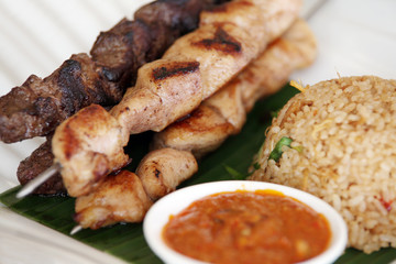 fried rice and brochettes