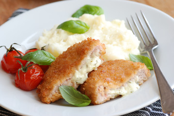 Chicken kievs with mashed potatoes