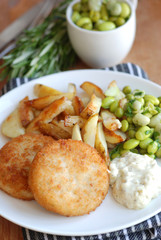 Fish cakes with chips and broad beans