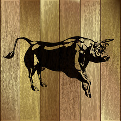 Bull on a Fence Background