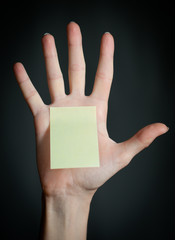 female hand with blank note