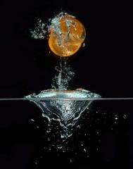 Orange jumping out of the water
