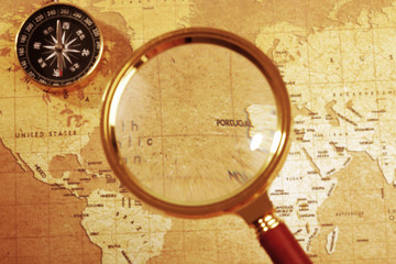 compass on a Treasure map background ,with Magnifier