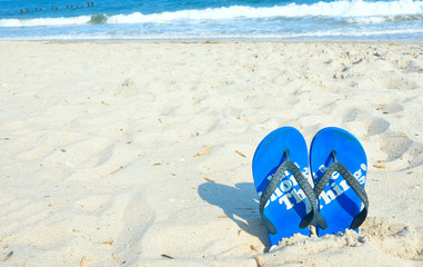 nice blue flip flops in the beach