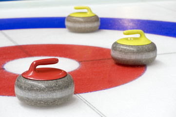 Garden Poster Winter sports Group of curling rocks on ice