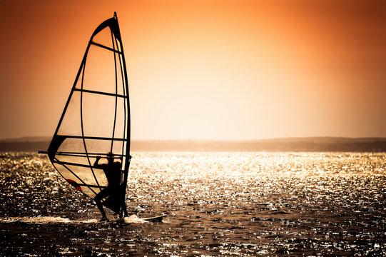 windsurfer silhouette on a sunset background