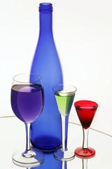 Dark blue bottle and three wine-glasses