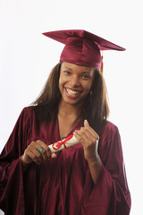 female college graduate in cap and gown with diploma