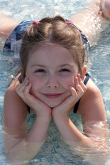 smiling girl in the swimming pool