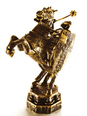 The old carved figure of a chess knight.