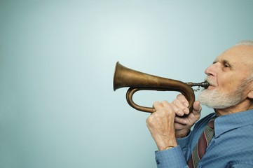 Profile Of Man Playing Horn