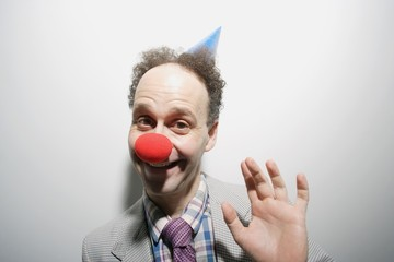 Man Wearing A Clown's Nose And Hat