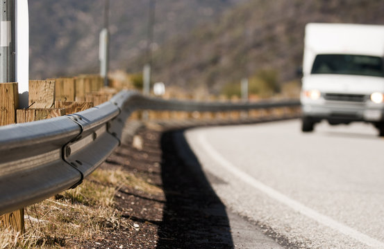 Highway guardrail on a mountain road