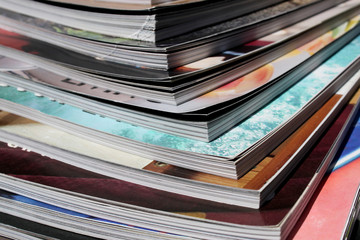 stack of colorful magazines close up