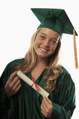female graduate in cap and gown with diploma.