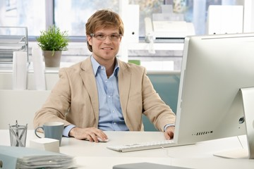Young businessman sitting at desk