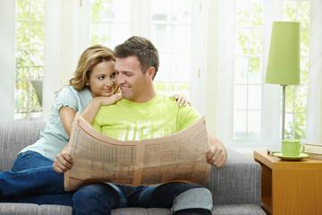 Love couple reading news