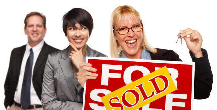 Real Estate Team with Woman Holding Keys and Sold For Sale Sign