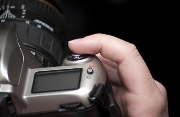 Female finger on shutter button