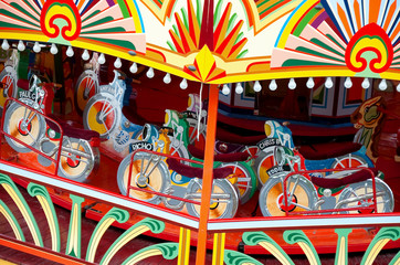 colorful motorcycle themed vintage fairground ride