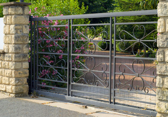 Beautiful black  gate, entrance to a front yard
