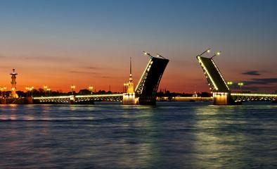 Raised Palace bridge at night in St-Petersburg, Russia