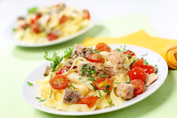 "Italian pasta ""penne"" with smoked salmon and other vegetables"