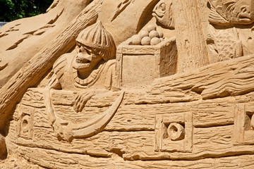 Figures from the sand, sunken ship