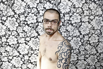 skinny tattoo guy on floral background