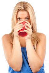 Beautiful young woman drinking coffee or tea