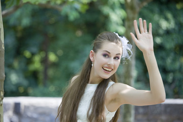 young bride waving with hand