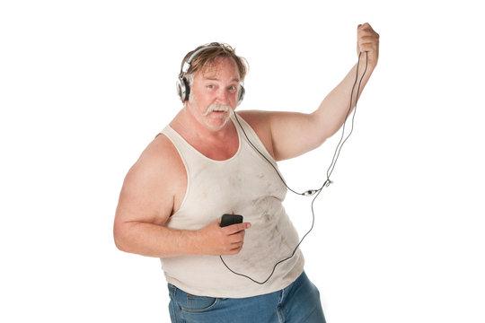 Man dancing to music on handheld audio device