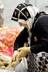 Woman buying potatoes in the market