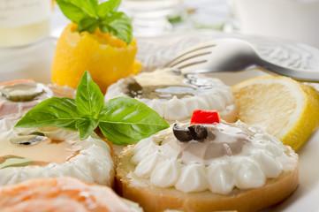 variety of canapes - antipasti tartine miste