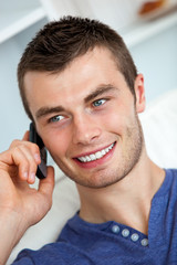 Handsome young man talking on phone