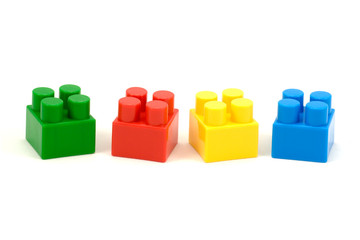 colorful plastic toy bricks ,isolated on white background