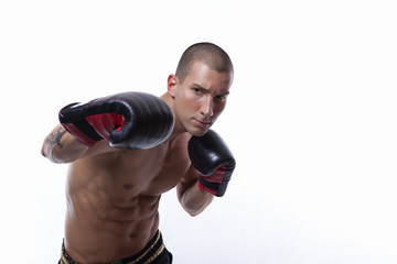 Sexy muscle young man with muay thai gloves