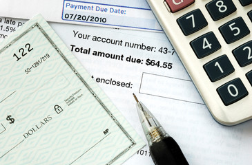 Write a check to pay the bills on time