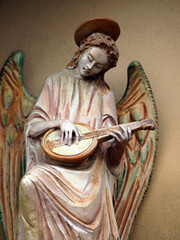 Sculpture of an angel with mandolin. Chiusi , Tuscany,