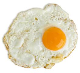 Greasy fried egg on white background