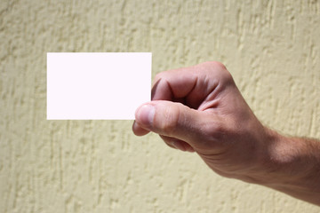 white card in a man's hand