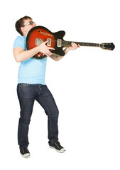 young man in glasses and blue shirt playing guitar isolated on w