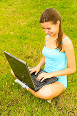 young woman resting with laptop